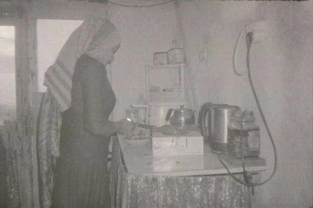 Photo by Walid he is 12 years old from Alasaka Syria ( Photo of his mother in kitchen ) copy